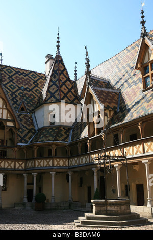 Superb Burgundian roof tiles on the roof of the Hospice Hotel-Dieu in Beaune Burgundy France Europe - Stock Photo