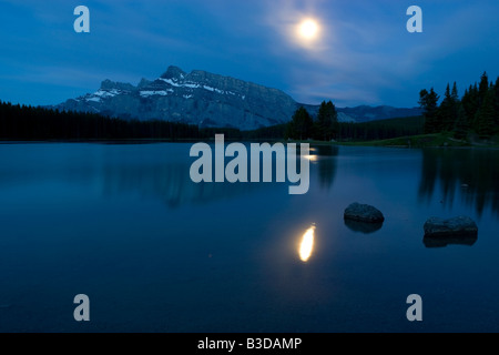 Moonrise over Mount Rundle in Banff National Park - Stock Photo