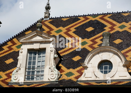 Superb Burgundian roof tiles on the Hospice Hotel-Dieu in Beaune Burgundy France Europe - Stock Photo