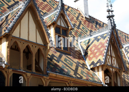 Superb Burgundian roof tiles on the dormers of the Hospice Hotel-Dieu in Beaune Burgundy France Europe - Stock Photo