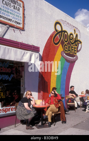 People sitting outside Joe's Cafe on Commercial Drive in Vancouver, Canada - Stock Photo