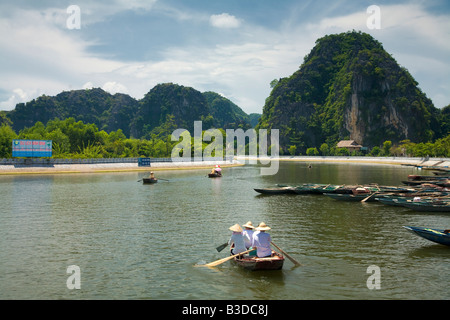 Boat rides at Ninh Binh for Tam Coc in North central Vietnam - Stock Photo