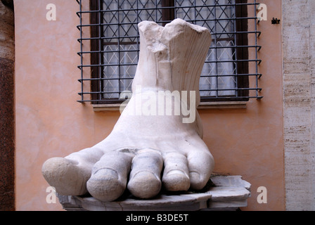 Enormous foot from statue of Emperor on Capitoline Hill Rome Italy - Stock Photo