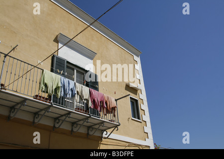 dressing gowns hanging on washing line in sun - Stock Photo