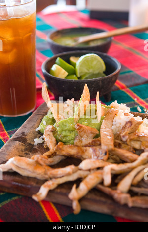 Chicken fajitas and other Mexican food in a restaurant in Mexico - Stock Photo