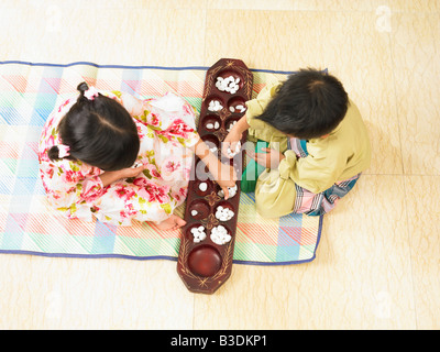 Playing traditional game together - Stock Photo