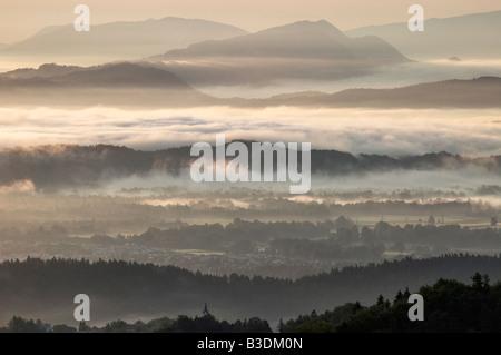 Dawn over mist shrouded Ljubljana Basin looking towards Kamnik Alps, Tehovec, Slovenia
