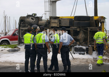 Police and fireman at scene of road traffic accident on Gran Canaria with foam and sand on road. - Stock Photo