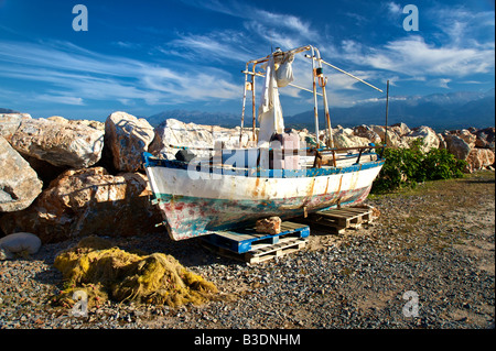 Old fisher boat at the popular beach of Marathi western Crete - Stock Photo