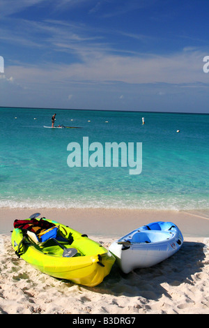 Colorful kayaks on Grace Bay Beach, Turks and Caicos. - Stock Photo