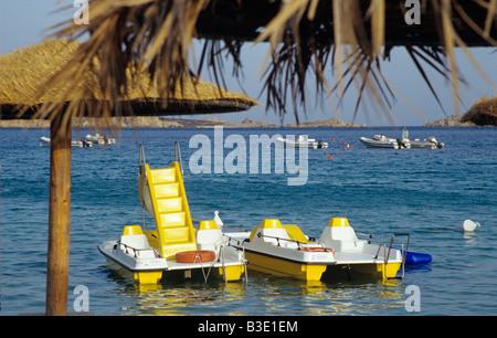 Italy, Sardinia, Pedal boats - Stock Photo