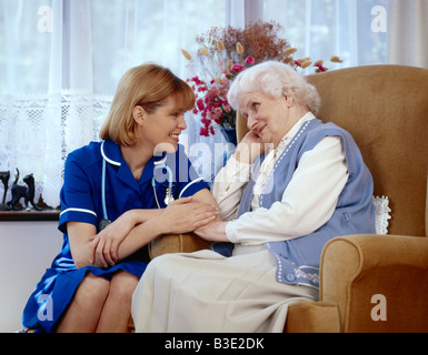 Nurse with elderly lady at home - Stock Photo