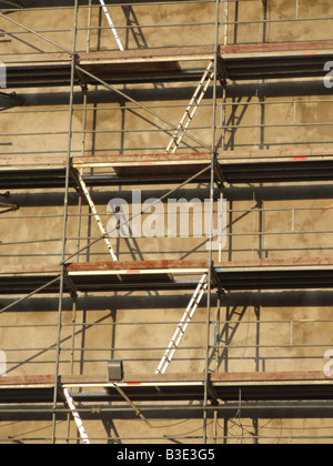 ladders and scaffolding on property building - Stock Photo