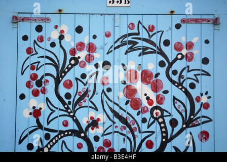 decorative artwork on beach huts in Domburg Netherlands - Stock Photo