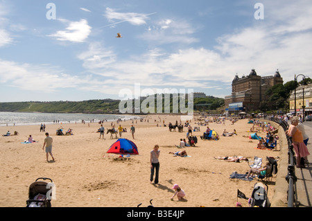 scarborough south beach traditional english seaside holiday town uk north yorkshire sunny day sand sandy day out - Stock Photo