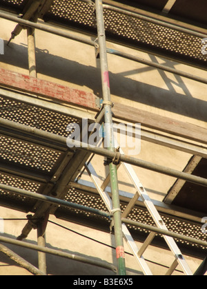 ladder and scaffolding on property building - Stock Photo
