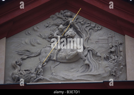 Detail of St George the Dragon Slayer on the front of St George Convent in Prague Castle, Prague - Stock Photo