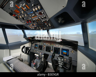Flight simulator Boeing 737 cockpit pilots training installation Seppe Airfield Noord Brabant Netherlands - Stock Photo