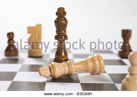 Chess pieces on a chess board - Stock Photo