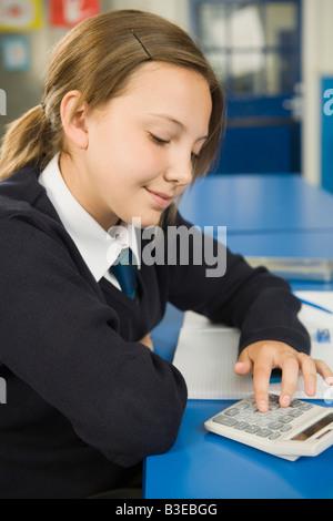 Girl using calculator - Stock Photo