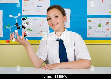 Girl with molecule model - Stock Photo