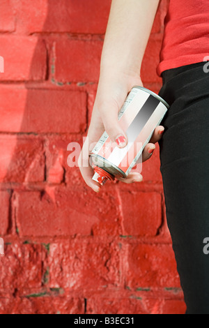 Girl with spray paint - Stock Photo
