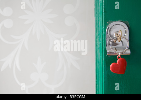 Key in front door - Stock Photo