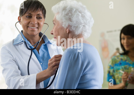 A doctor examining a patient - Stock Photo