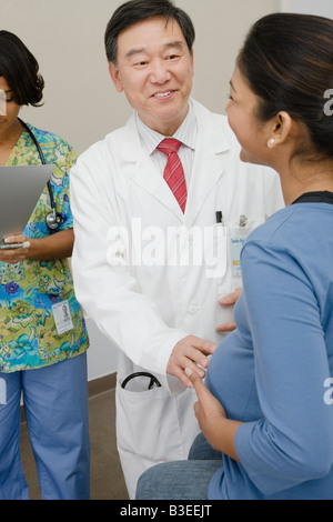 A doctor examining a pregnant patient - Stock Photo