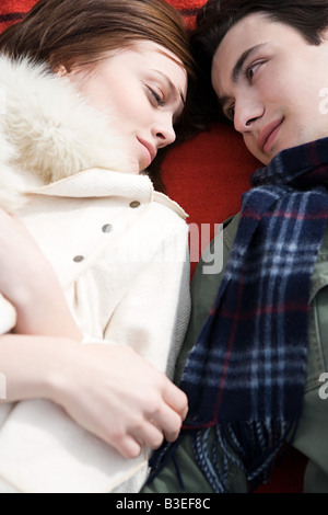 Young couple lying down - Stock Photo