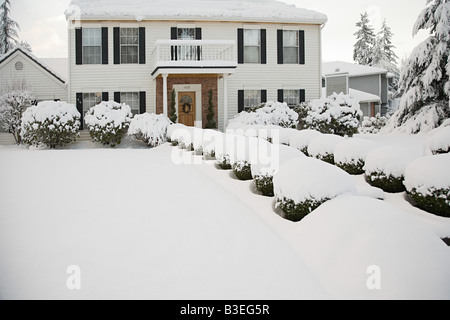 House and garden in the snow - Stock Photo