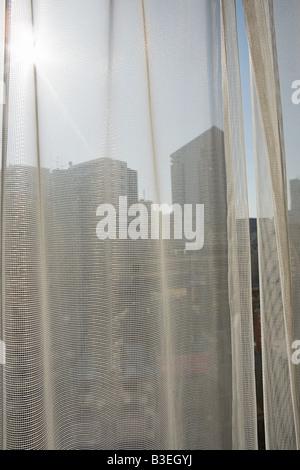 Sunlight on net curtain - Stock Photo