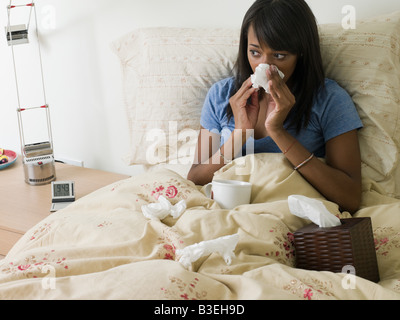 Woman in bed with cold - Stock Photo