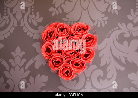 Artificial roses in heart shape - Stock Photo