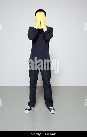 Man wearing rubber gloves - Stock Photo