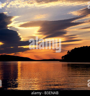 Beautiful golden sunset over Loch Ewe, Poolewe, Wester Ross, Scotland - Stock Photo