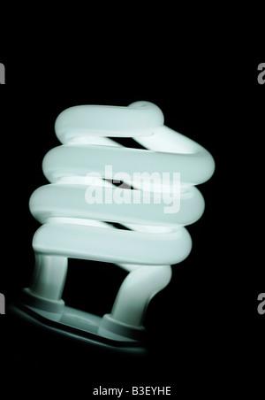 Energy Saving Compact Fluorescent Lightbulb Close Up an Environmentally Friendly Alternative to Traditional Light - Stock Photo