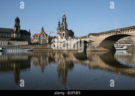 Dresden skyline, Catholic Hofkirche and Augustusbrucke reflected in River Elbe Dresden Germany  June 2008 - Stock Photo