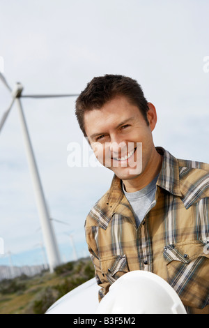 Engineer at wind farm, portrait - Stock Photo