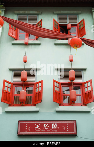 Red and green shophouse facade Chinatown, Singapore - Stock Photo