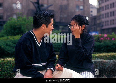 Mexicans, Mexican man, Mexican woman, young adults, college students, university students, couple, talking, Mexico - Stock Photo
