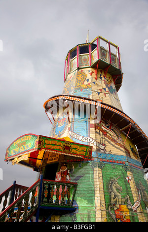 Old traditional wooden Helter-Skelter, a Childrens's fairground spiral slide,  at Chatsworth Country Fair, Derbyshire, - Stock Photo