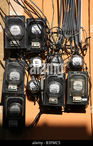 Electric meters on the wall in the Zona Colonial of Santo Domingo, Dominican Republic - Stock Photo