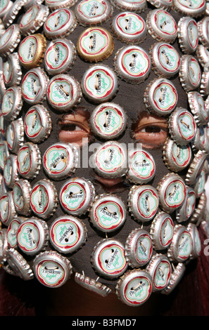 Carnival participant covering by bottle caps performing during Santo Domingo Carnival, Dominican Republic - Stock Photo