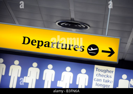 Royalty free photograph of departure sign for emigrating people at airport. - Stock Photo