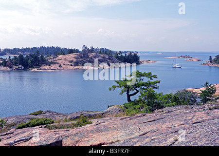 Sailboat among Thirty Thousand Islands in eastern Georgian Bay Ontario Canada - Stock Photo