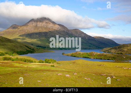 Mountain scenery Loch Lurgainn and Cul Beag with it s summit enveloped in clouds Wester Ross Highlands Scotland - Stock Photo
