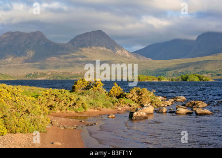 Mountain scenery view from the shores of Loch Lurgainn towards Cul Beag and Beinn an Eoin with blooming - Stock Photo