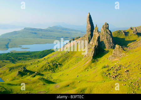Mountain scenery rolling green slopes and bizarre rock formation Old Man of Storr seen from above - Stock Photo