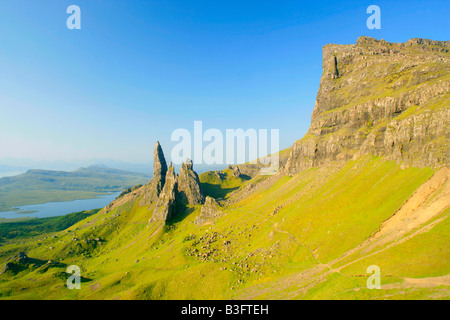 Mountain scenery rolling green slopes cliffs of The Storr and bizarre rock formation Old Man of Storr seen from - Stock Photo